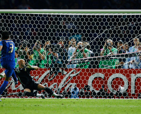 BERLIN - JULY 09:  Fabio Grosso of Italy scores the winning penalty in a penalty shootout at the end of the FIFA World Cup Germany 2006 Final match between Italy and France at the Olympic Stadium on July 9, 2006 in Berlin, Germany.  (Photo by Shaun Botterill/Getty Images)